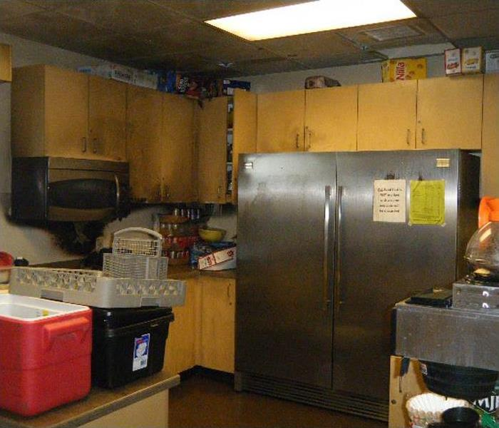 Commercial kitchen with fire and smoke damage