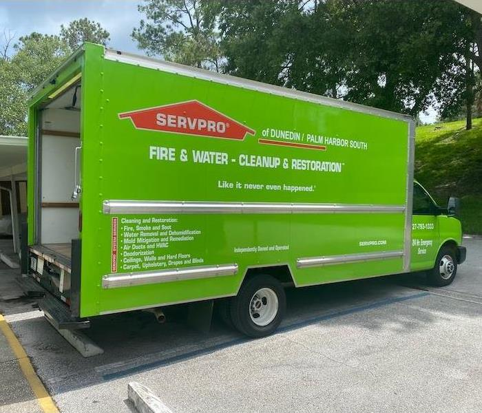 Green SERVPRO vehicle at a job site ready for action.