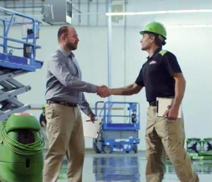 SERVPRO Employee Shaking Hands with Business Owner